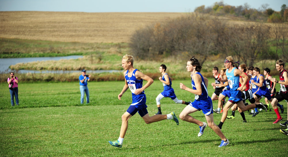 NICK INGRAM/Citizen photo West Platte sophomore Max Davies, left, and junior Andy Cicha take off at the start of the Class 1 District 8 meet Saturday, Oct. 29 at Donaldson West Side Park in Maryville, Mo.