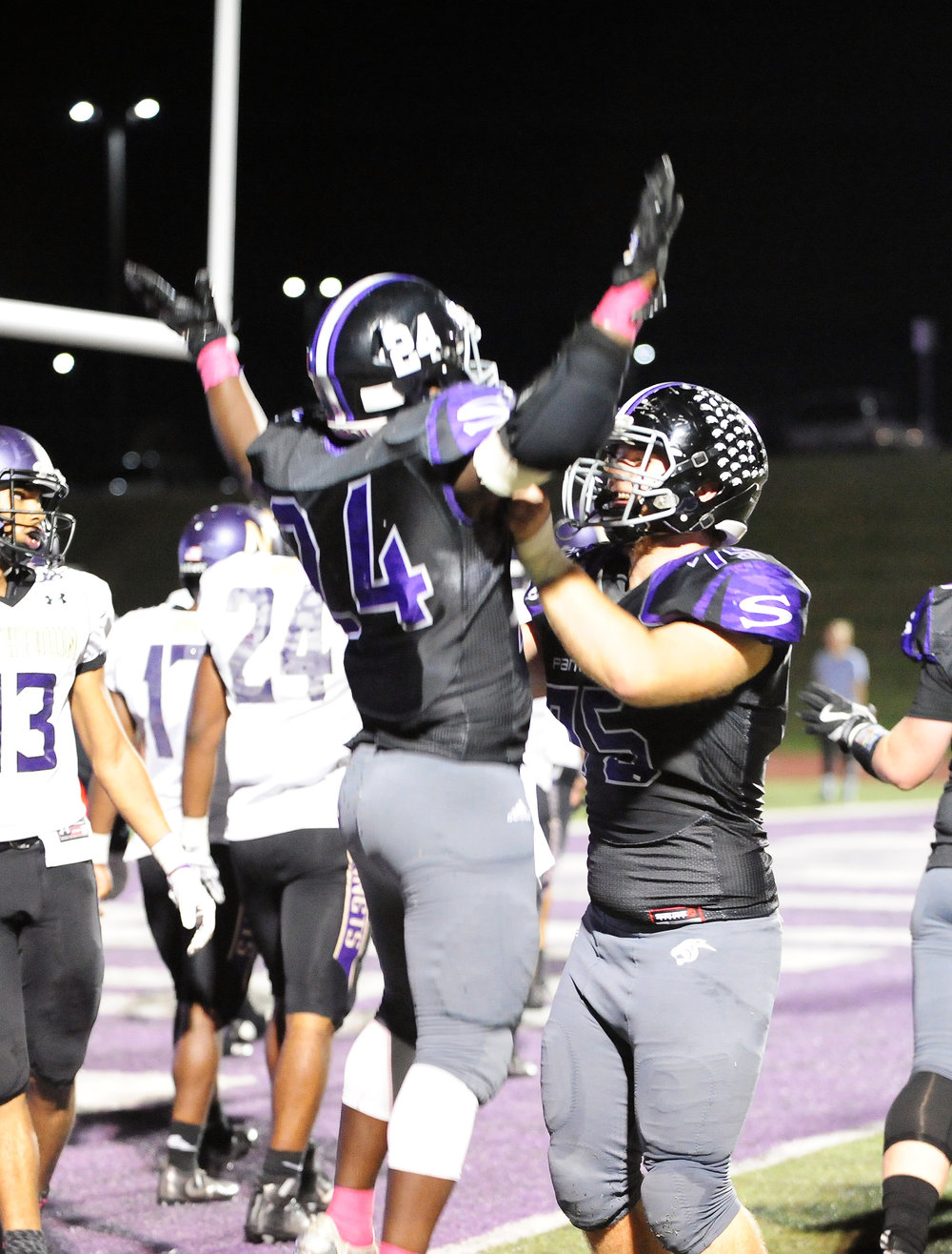 NICK INGRAM/Citizen photo Park Hill South senior running back Emanuel Butler (24) is lifted up by sophomore Christian Holferty after Butler scored a touchdown on Friday, Oct. 29 at Park Hill District Stadium in Kansas City, Mo.