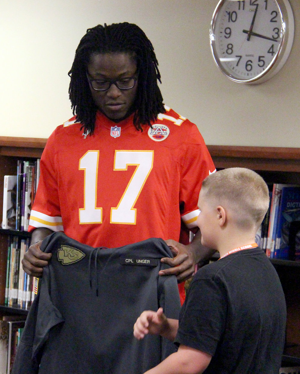 ROSS MARTIN/Citizen photo Kansas City Chiefs wide receiver Chris Conley presents 11-year-old Gage Unger with a custom hooded sweatshirt, bearing the name of Unger's late father Cpl. David Unger who was killed in October of 2006 while serving the United States Army in Iraq.