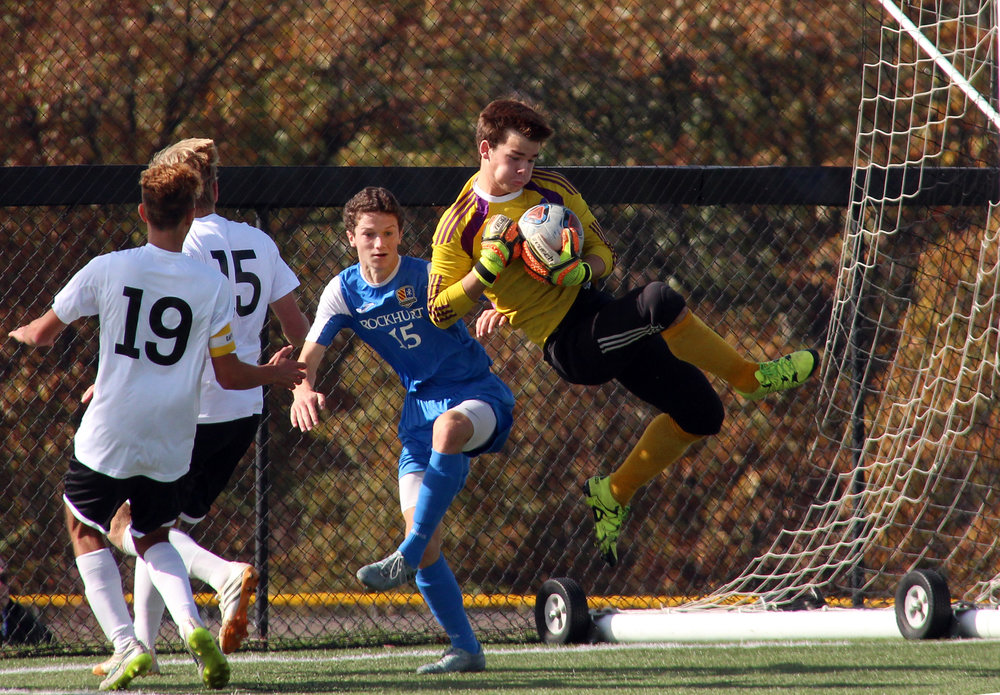 ROSS MARTIN/Citizen photo Park Hill South senior goalkeeper Noah Brizendine (right) goes up to catch a cross from the Rockhurst offense in a Class 4 quarterfinal Saturday, Nov. 5 at Park Hill District Soccer Complex in Riverside, Mo.