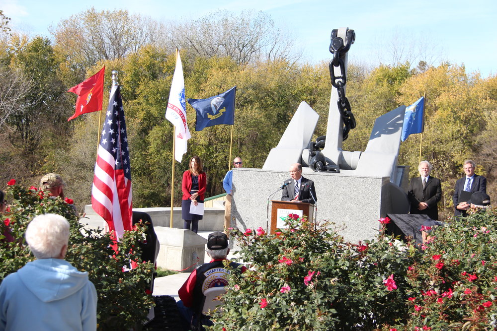 ROSS MARTIN/Citizen photo Platte City mayor Frank Offutt speaks to a crowd gathered at the Platte City Veterans Memorial Monument on Friday, Nov. 11. at Settler's Crossing Park. The City of Platte City held a dedication ceremony for the recently completed landmark.