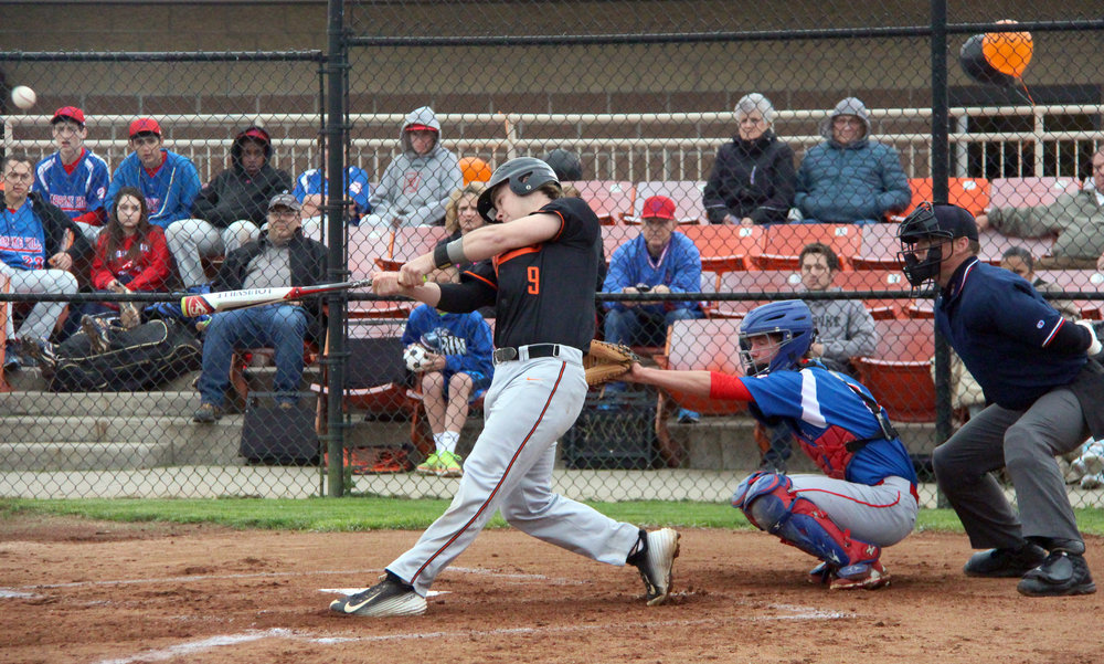 Citizen file photo Platte County senior Justin Mitchell hits a fly ball during a game against Pembroke Hill last spring at Platte County High School. He recently signed his national letter of intent to continue playing at Oklahoma University.