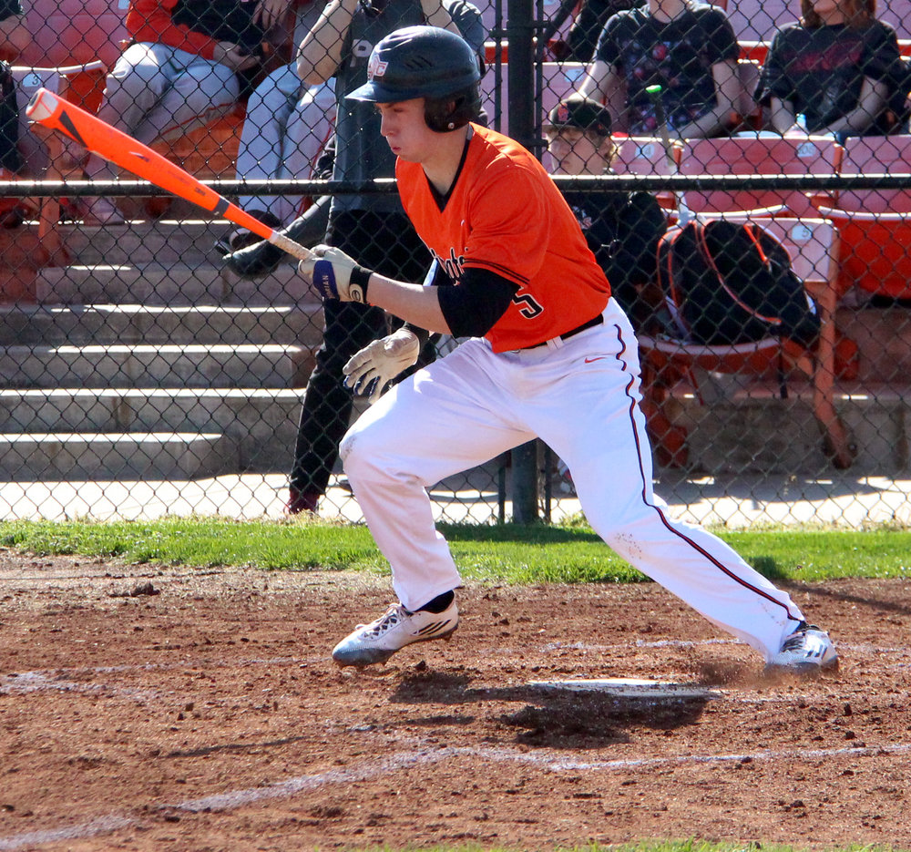 Citizen file photo Platte County senior Colton Horn starts to run to first base in a game against Oak Grove last spring at Platte County High School.