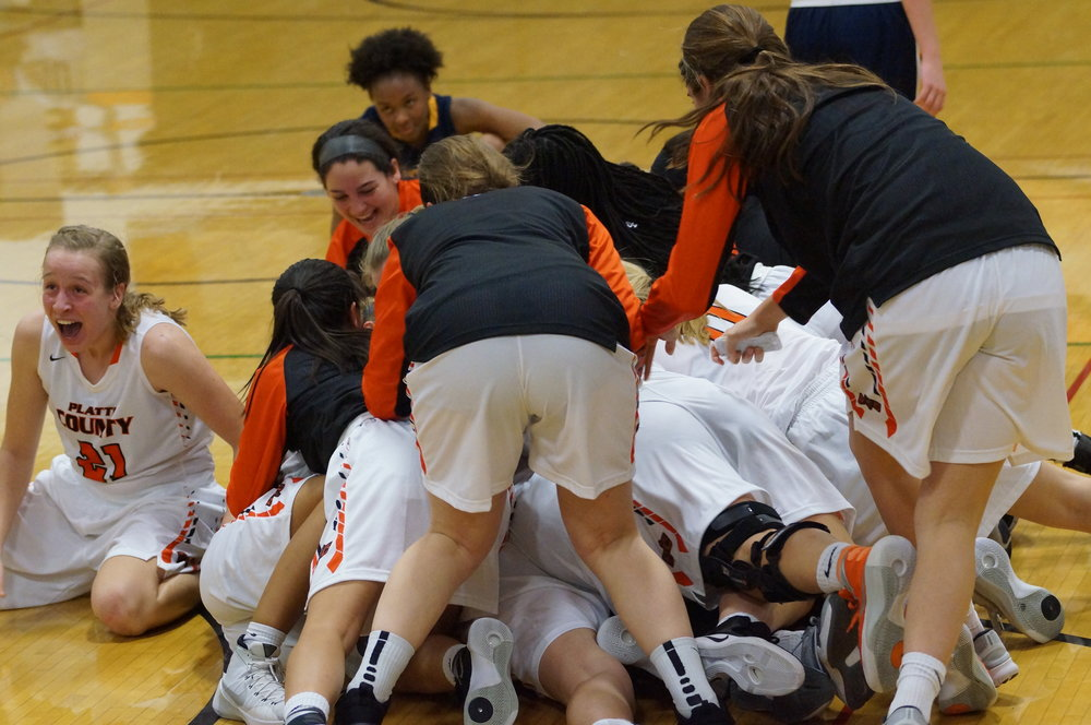 CHRIS PATTERSON/Citizen photo Platte County players, including sophomore Jaycie Stubbs (21), celebrate with Rockey Chambers following her game-winning 3-pointer Tuesday, Nov. 22 at Platte County High School.