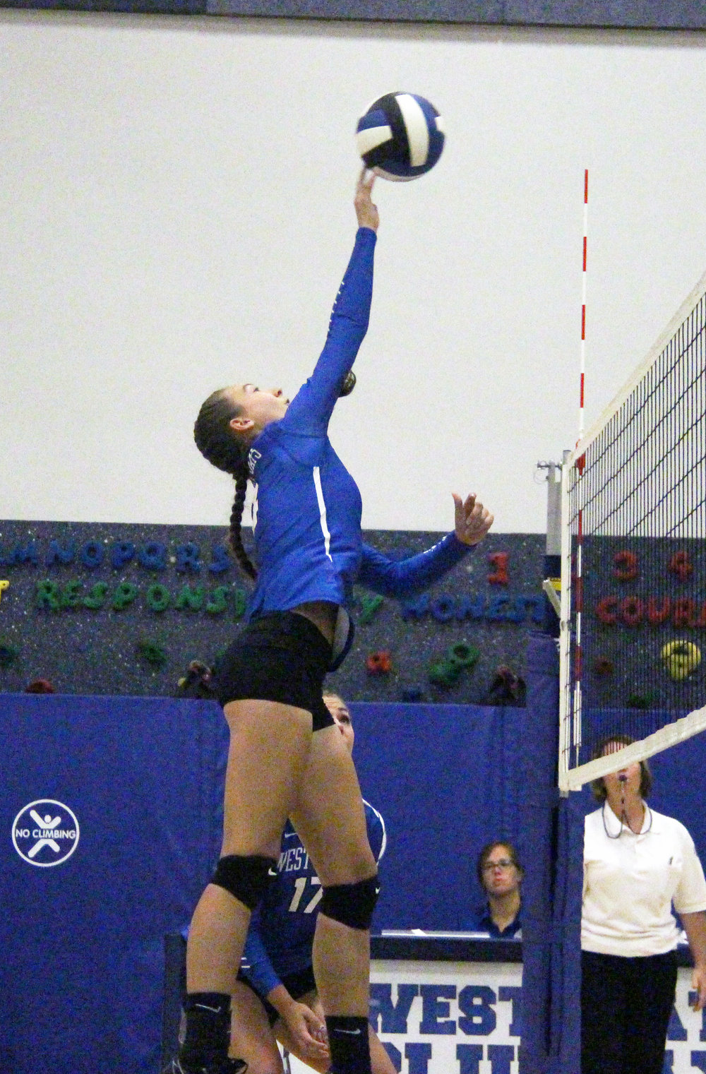 Citizen file photo West Platte senior Jordan Schultz tips a ball over the net during a September match with East Buchanan at West Platte Elementary School in Weston, Mo. Schultz received multiple postseason honors.