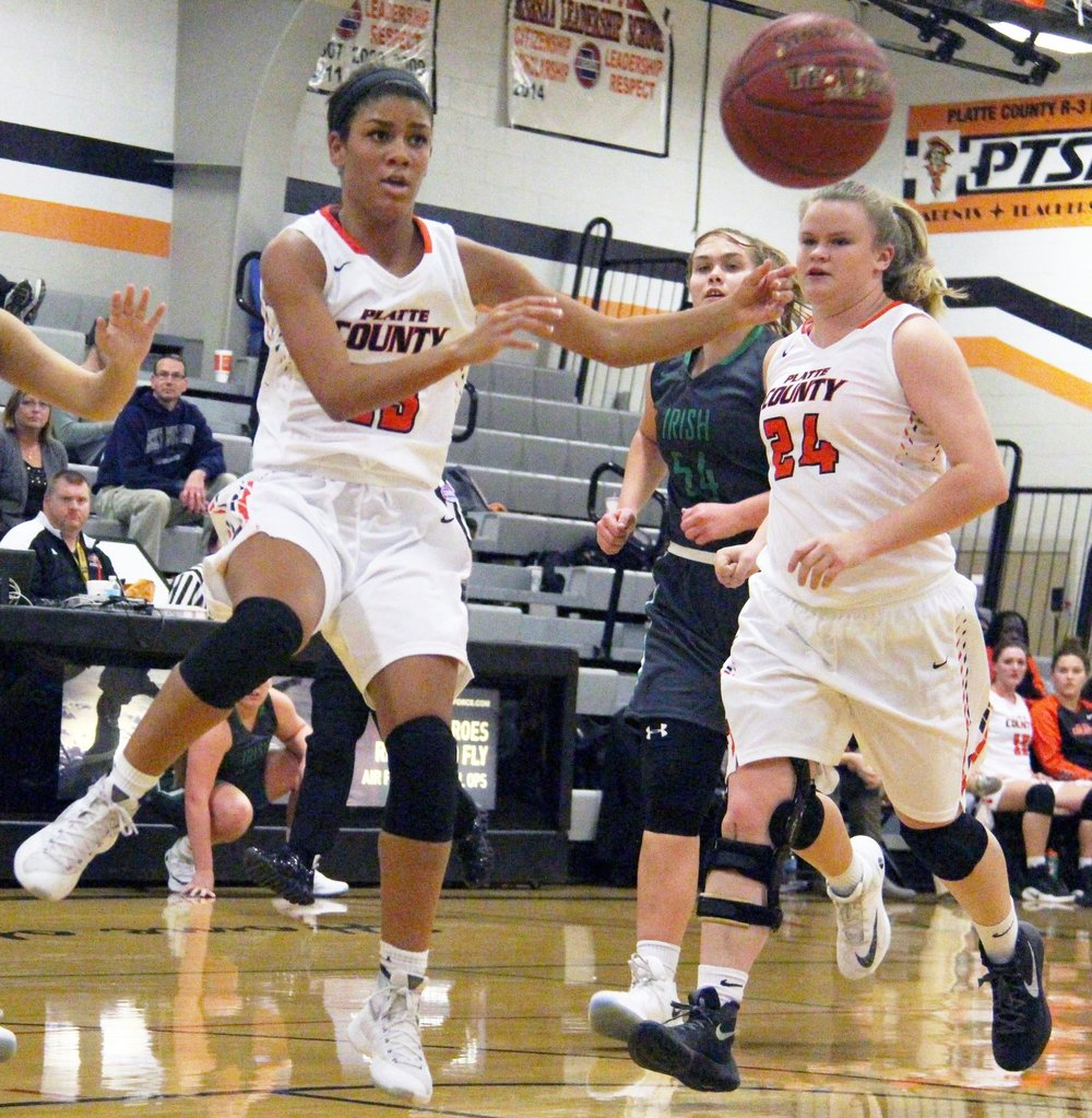 ROSS MARTIN/Citizen photo Platte County senior guard Ava White, left, passes the ball with senior Liz Peterson following close behind during a game against St. Joseph Lafayette on Friday, Dec. 9 at Platte County High School.