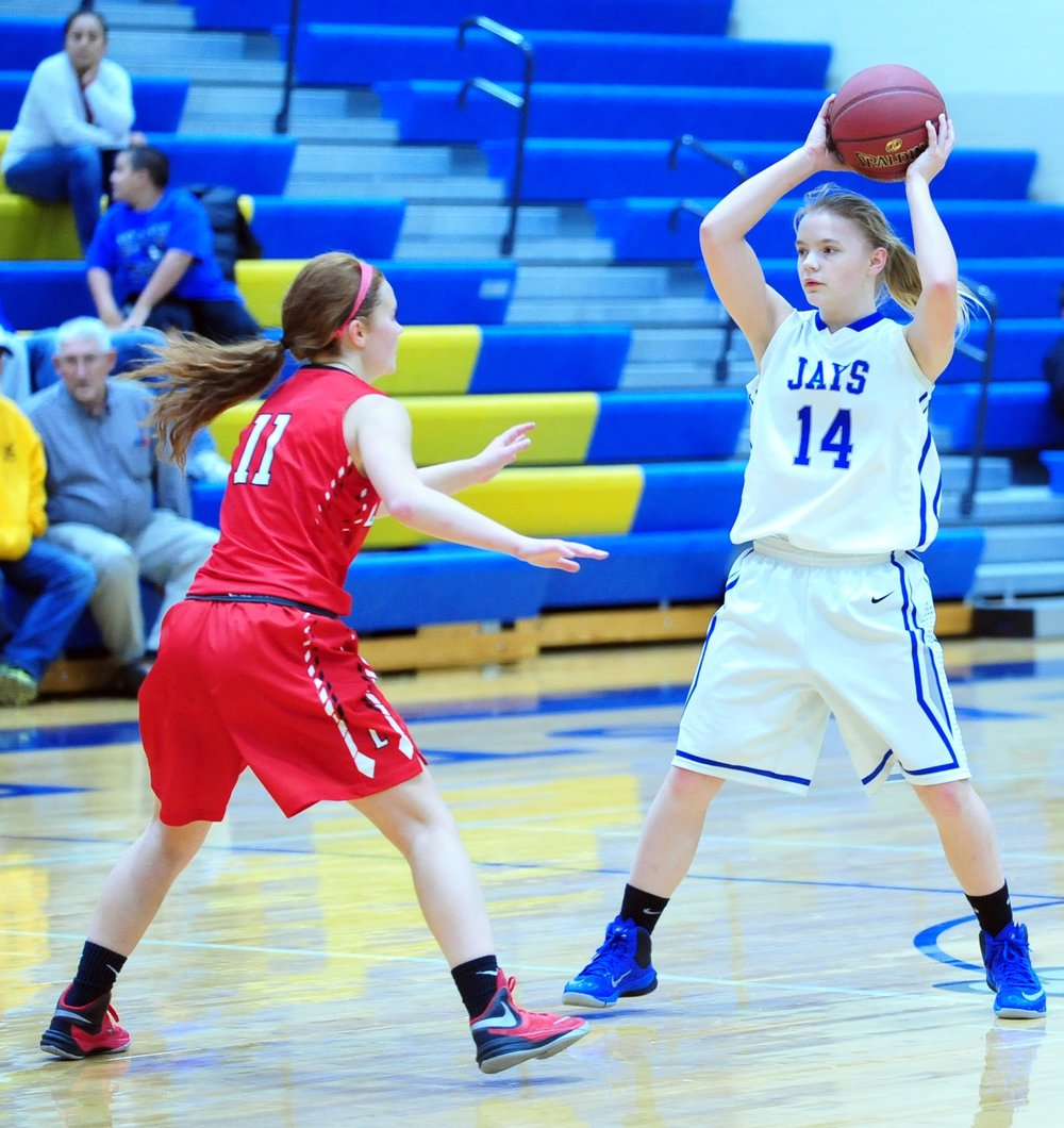 NICK INGRAM/Citizen photo West Platte freshman Faith Stevens (14) looks to make a pass against Lawson in the third-place of the KCI Conference Tournament third-place game Thursday, Dec. 8 at East Buchanan High School in Gower, Mo.