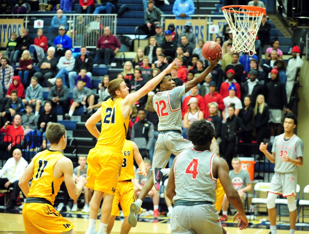 NICK INGRAM/Citizen photo Park Hill senior Dru Smith goes in for a layup against Liberty North during the Liberty North Invitational championship game on Friday, Dec. 9 at Liberty North High School.