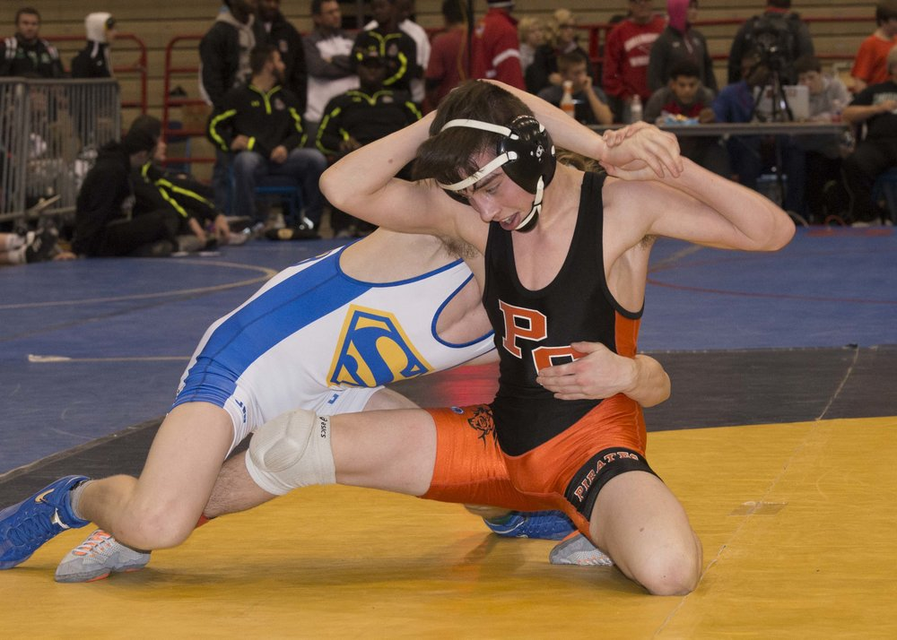 DAVID BREDESON/Special to The Citizen Platte County junior Cody Phippen, right, wrestles against Seckman's Kai Orine in the 113-pound fifth-place match Saturday, Dec. 17 during the Kansas City Stampede Tournament at Hale Arena in Kansas City, Mo.