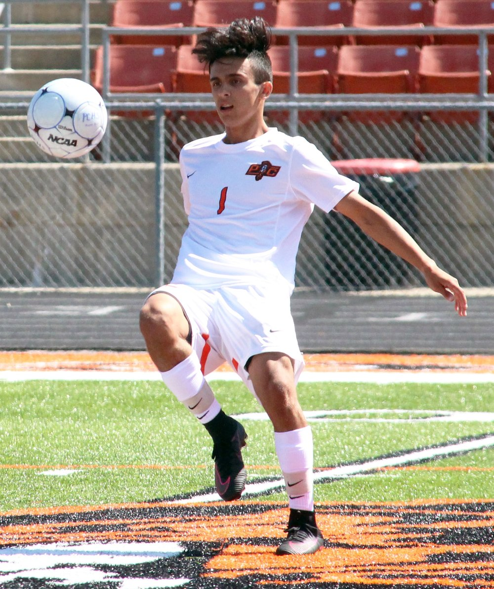 ROSS MARTIN/Citizen photo Platte County junior Chandler Peterson works to control the ball in a September game against Rockwood Summit at Pirate Stadium. Peterson scored 61 goals this season and made the Missouri State High School Soccer Coaches Assocaition all-state list in Class 3 for a second straight year.