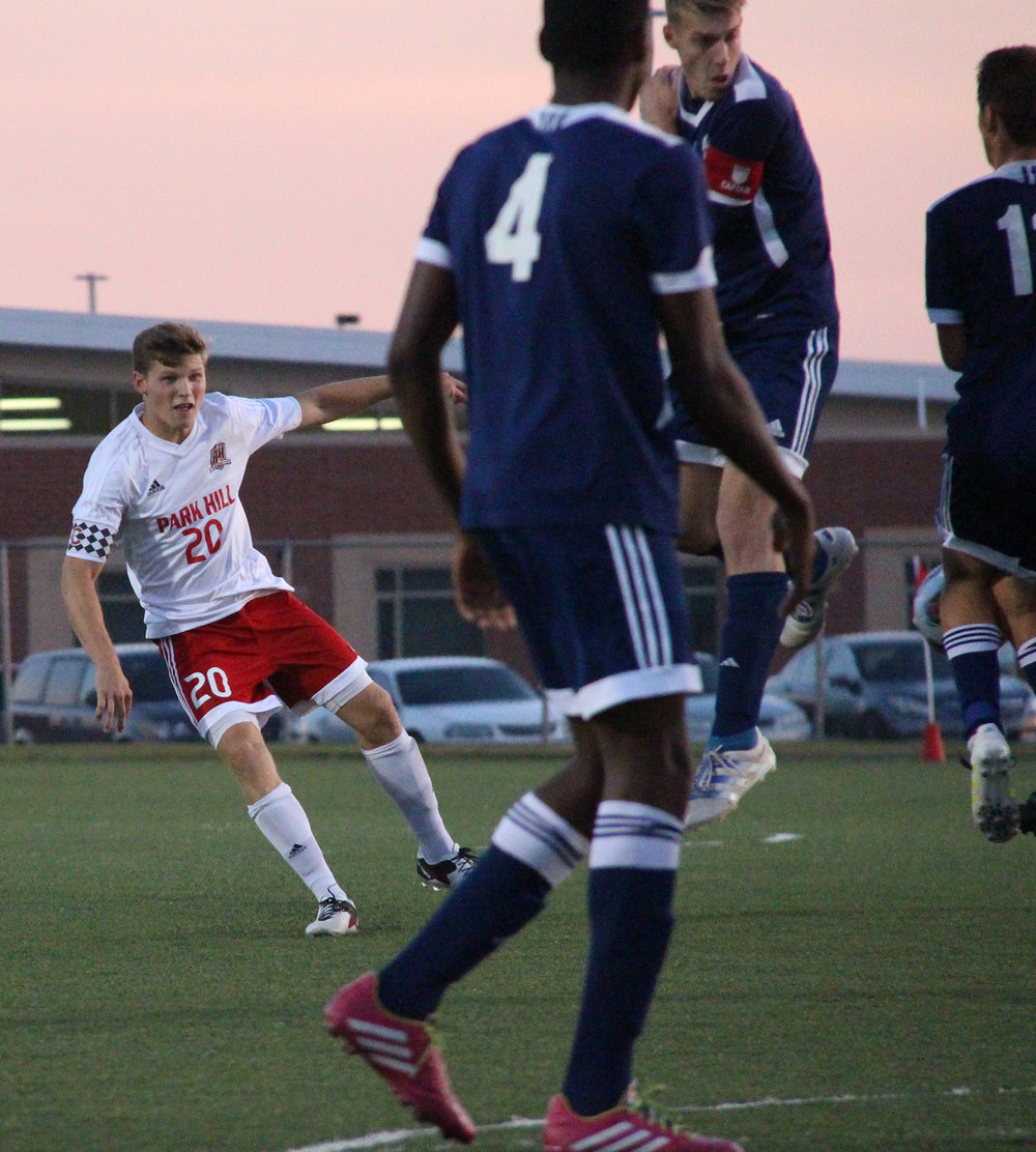 ROSS MARTIN/Citizen photo Park Hill senior defender Jackson Foutch watches his free kick go into a wall of defenders during the Class 4 District 16 championship game last month in Kansas City, Mo.