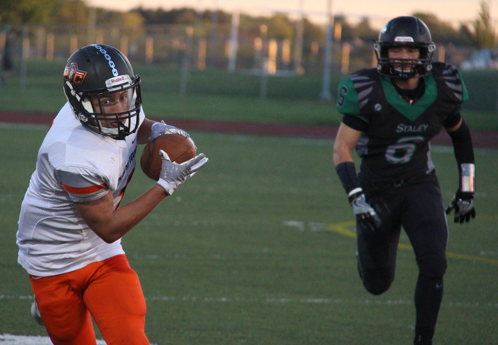 Citizen file photo Platte County wide receiver TJ Guillory (left)