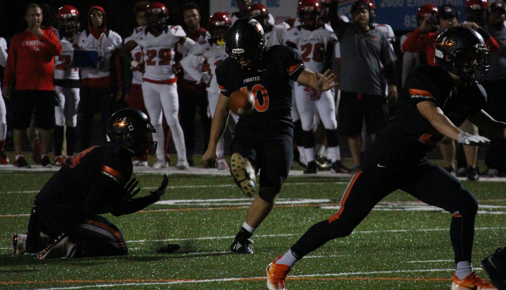 Citizen file photo Platte County kicker Parker Lacina (center)