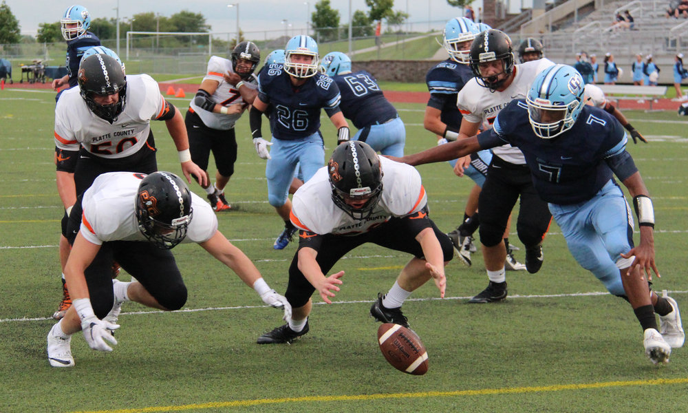 Citizen file photo Platte County linebacker Dakota Schmidt (center)
