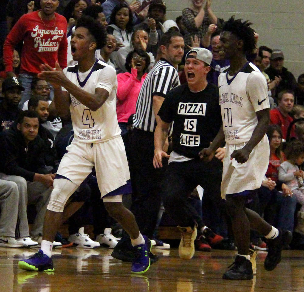 ROSS MARTIN/Citizen file photo Park Hill South sophomore guard Desi Williams (4) and Lamel Robinson (11) react to Williams' 3-pointer at the second-quarter buzzer against Park Hill on Wednesday, Dec. 21 at Park Hill South High School in Riverside, Mo. Park Hill South student Andrew Aswegan an onto the court to celebrate the shot.