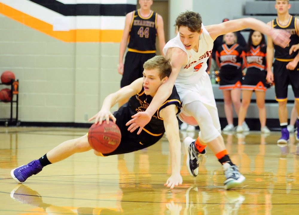 NICK INGRAM/Citizen photo Platte County sophomore guard Ethan Esdohr, right, attempts to take the ball from a Kearney player during the Pirates' loss to Kearney on Friday, Jan. 6 at Platte County High School.
