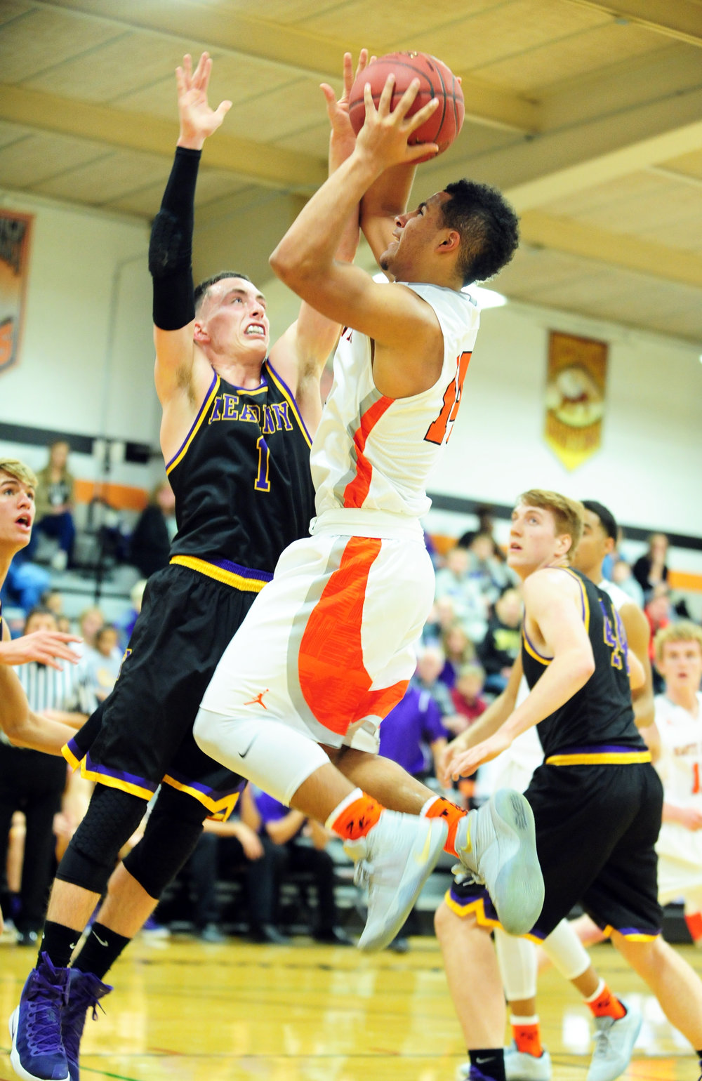 NICK INGRAM/Citizen photo Platte County junior Kobe Cummings, right, takes a shot over a Kearney defender during the Pirates' loss to Kearney on Friday, Jan. 6 at Platte County High School.