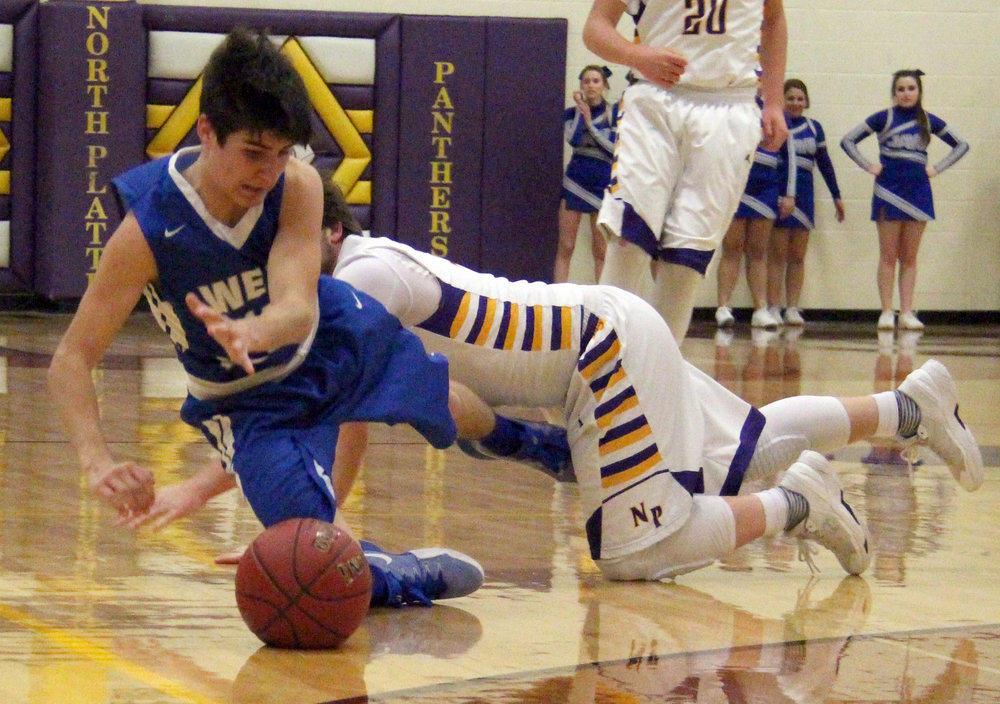 ROSS MARTIN/Citizen photo North Platte's Hunter Oliver, right, collides with and fouls West Platte's Shayne Kleinsorge on Friday, Jan. 6 at North Platte High School in Dearborn, Mo.