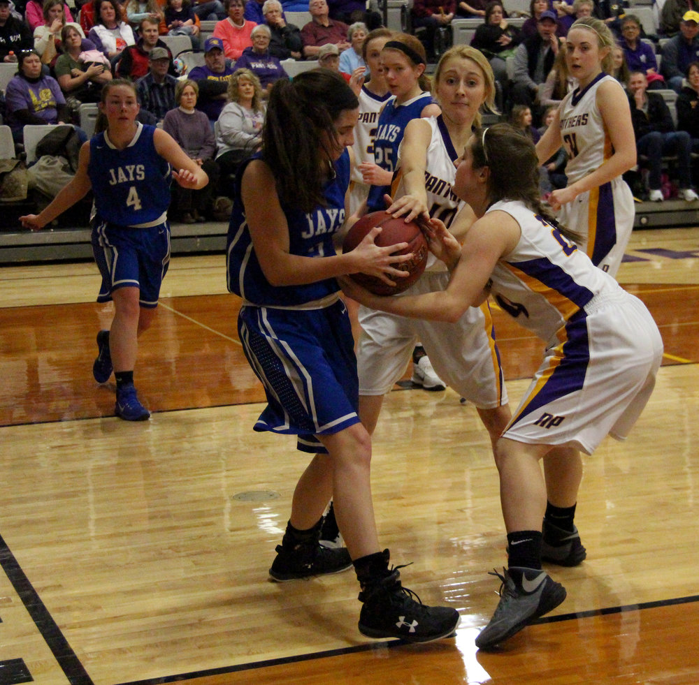 ROSS MARTIN/Citizen photo West Platte sophomore Lea Moose, left, attempts to keep the ball away from North Platte's McKenna Fulton, center, and Mackenzie Sams on Friday, Jan. 6 at North Platte High School in Dearborn, Mo.