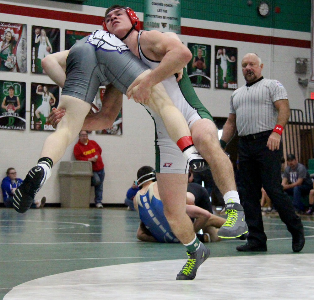 ROSS MARTIN/Citizen photo Mid-Buchanan's Parker Rotterman, right, picks up South Harrison's Gavin Johns during their 160-pound semifinal match Saturday, Jan. 7 in the Mid-Buchanan Invitational at Mid-Buchanan High School in Faucett, Mo.