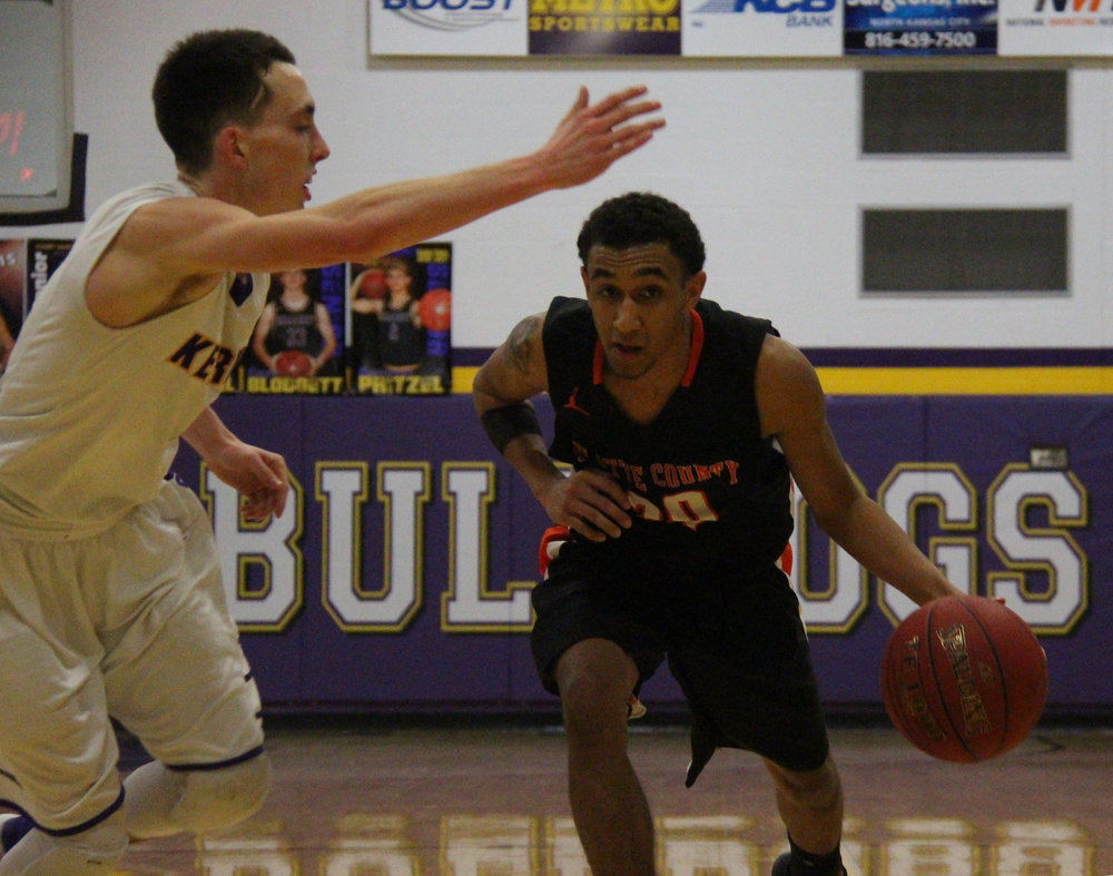 ROSS MARTIN/Citizen photo Platte County senior guard DeAndre Rollins dribbles up court against Kearney in the Bulldog Classic championship game Monday, Jan. 16 at Kearney High School in Kearney, Mo.