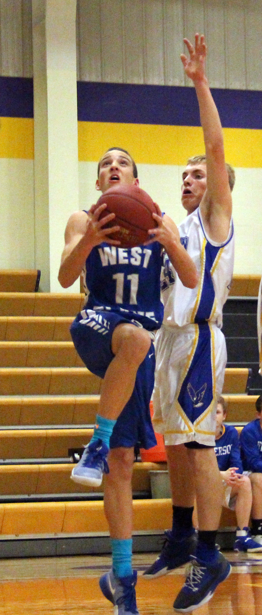 ROSS MARTIN/Citizen photo West Platte freshman Phillip Pattison (11) goes up for a layup against the Jefferson defense in a North Platte Invitational pool game Monday, Jan. 23 at North Platte High School in Dearborn, Mo.