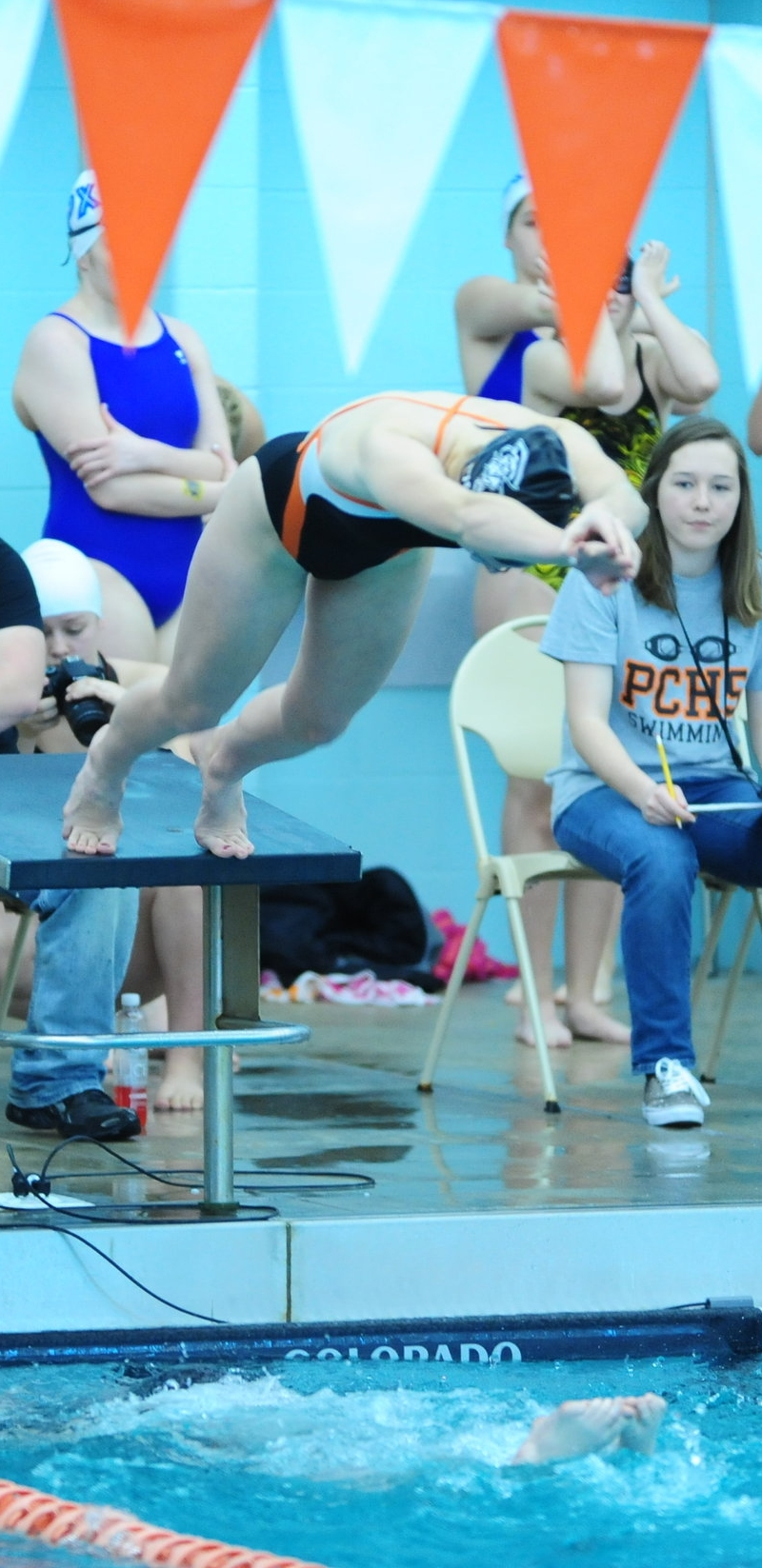 NICK INGRAM/Citizen photo Platte County senior Hannah Havemeier dives in to start her leg of the 200-yard medley relay race during the Platte County Invitational on Saturday, Jan. 21 at Platte County Community Center North in Platte City.