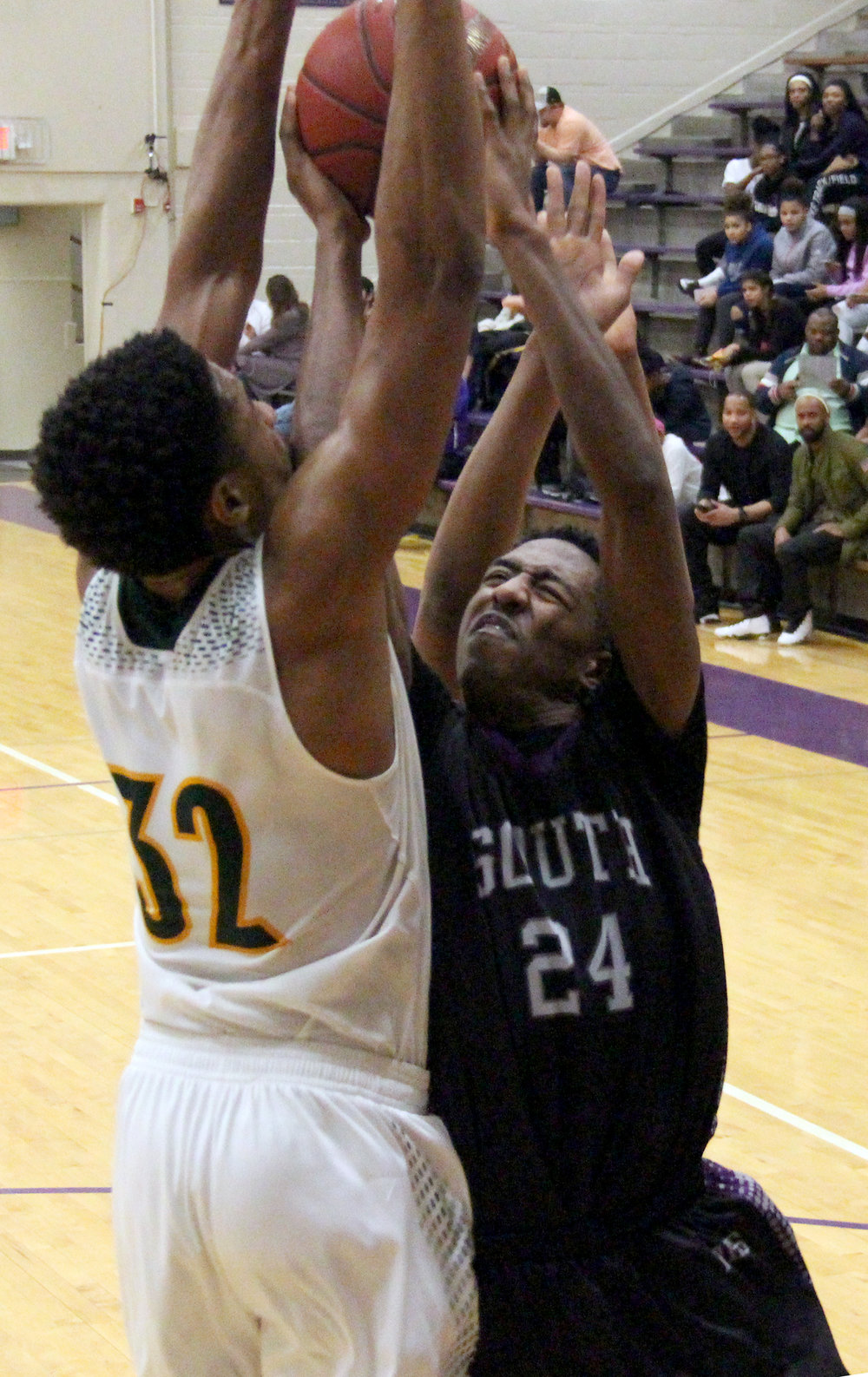 ROSS MARTIN/Citizen photo Park Hill South junior Saadique Perkins (24) goes up for a shot against Rock Bridge in the North Kansas City Invitational championship game Friday, Jan. 20 in North Kansas City, Mo.