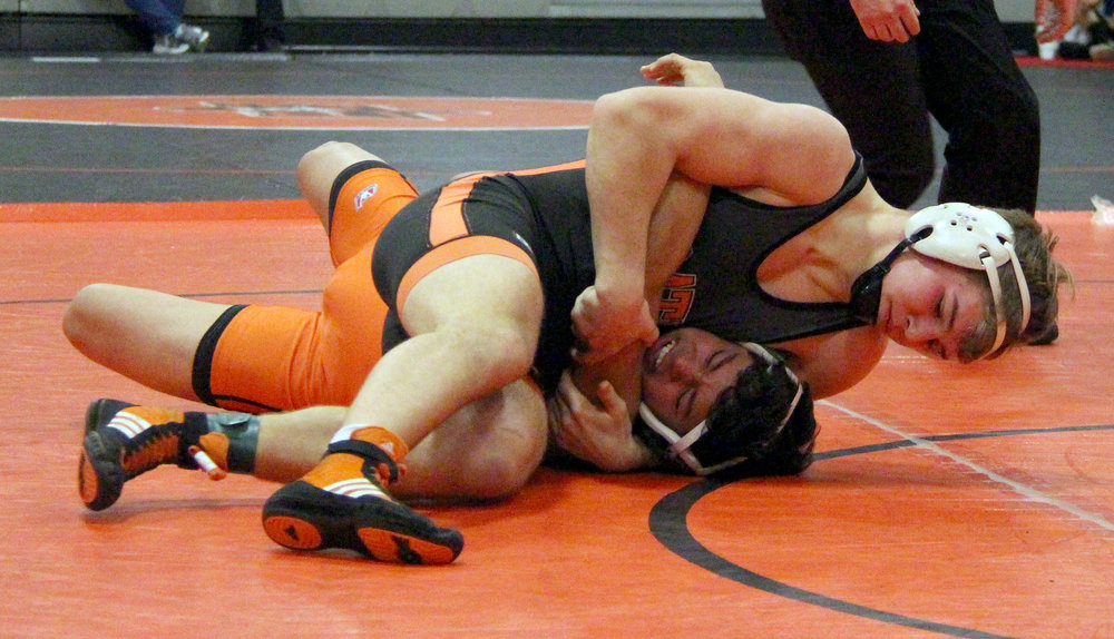 ROSS MARTIN/Citizen photo Platte County senior Jaron Hoegler, top, works to pin Kirksville's Parker Laudwig in a 145-pound match during the Platte County Invitational on Saturday, Jan. 21 at Platte County High School.