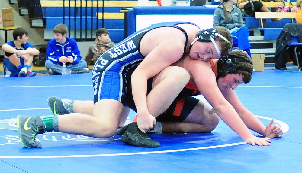 NICK INGRAM/Citizen photo West Platte sophomore Thomas Tharp, top, controls Platte County sophomore Glen Gammill in a 285-pound match during the West Platte Invitational on Saturday, Jan. 28 in Weston, Mo.