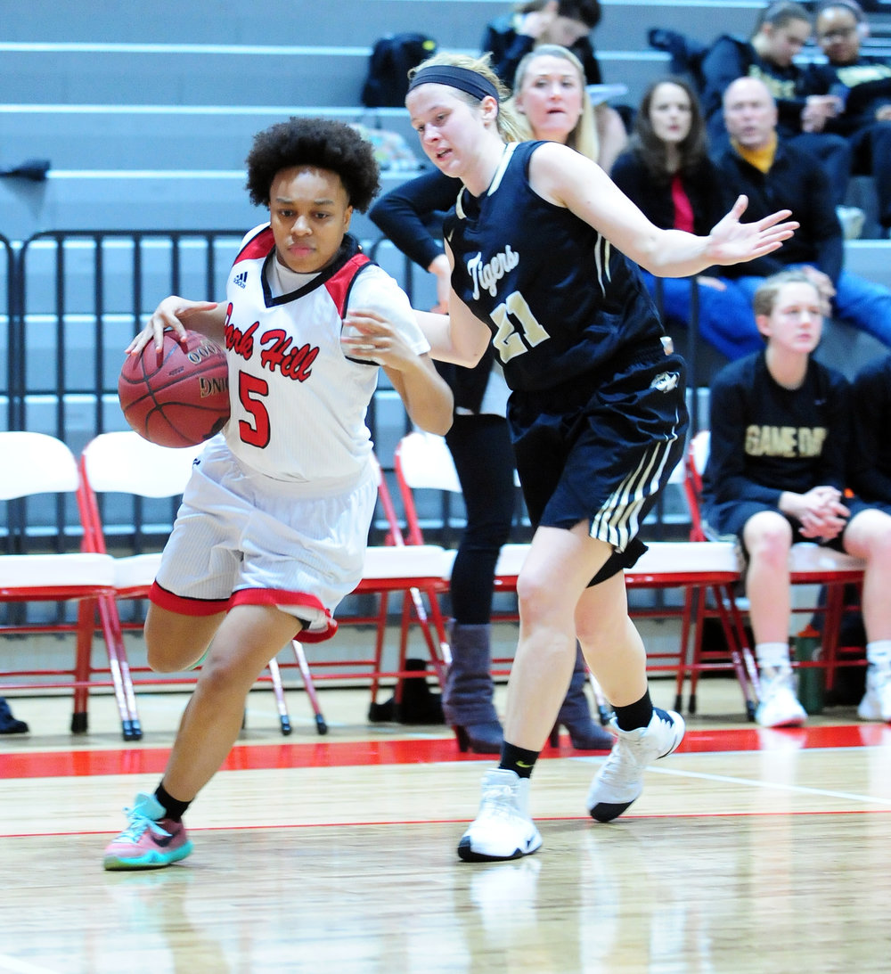 NICK INGRAM/Citizen photo Park Hill senior guard Leah Reed, left, dribbles past a Lee's Summit defender Thursday, Jan. 26 at Park Hill High School in Kansas City, Mo.