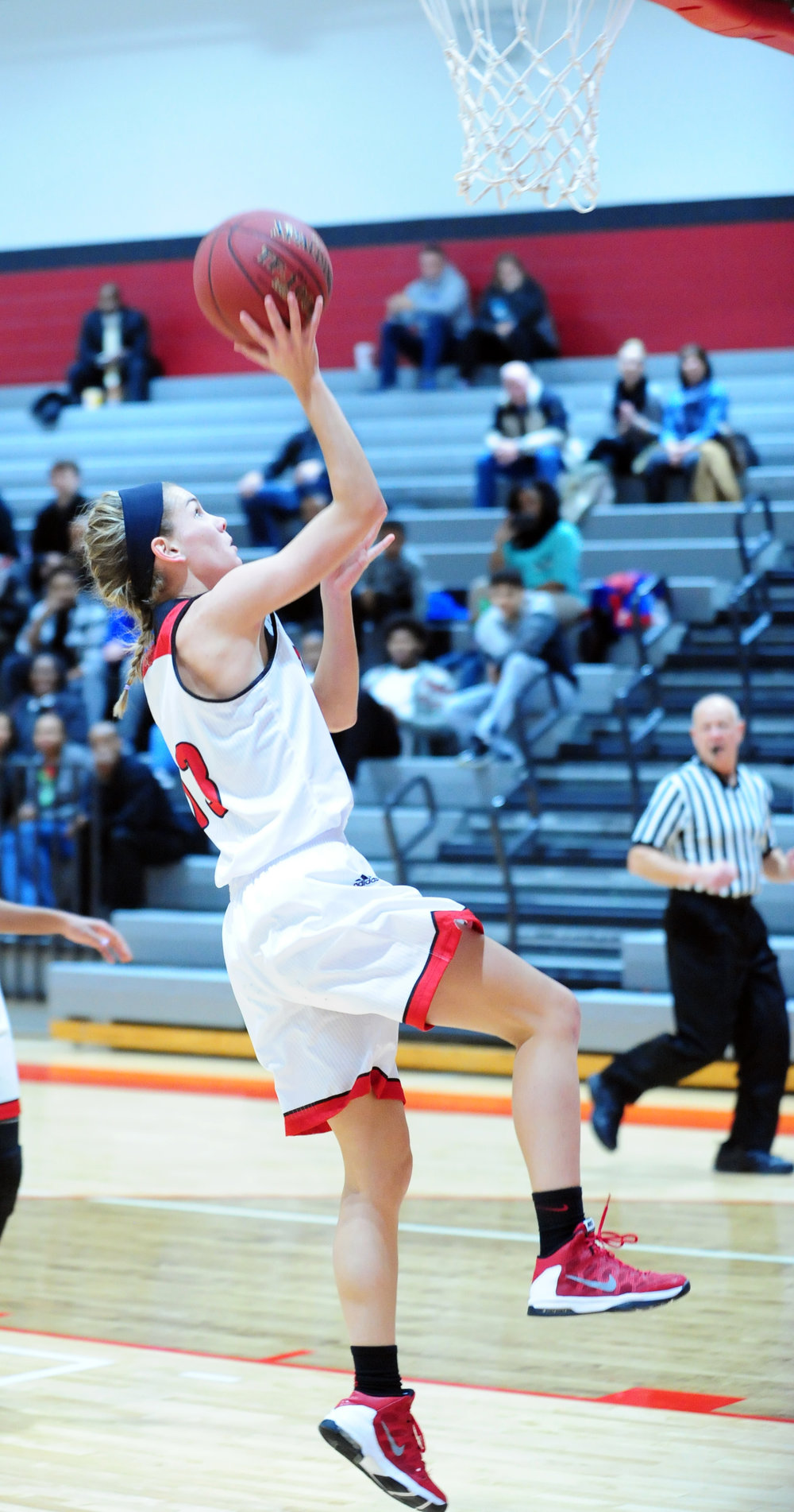 NICK INGRAM/Citizen photo Park Hill senior guard Jenna Winebrenner goes in for a layup against Lee's Summit on Thursday, Jan. 26 at Park Hill High School in Kansas City, Mo.