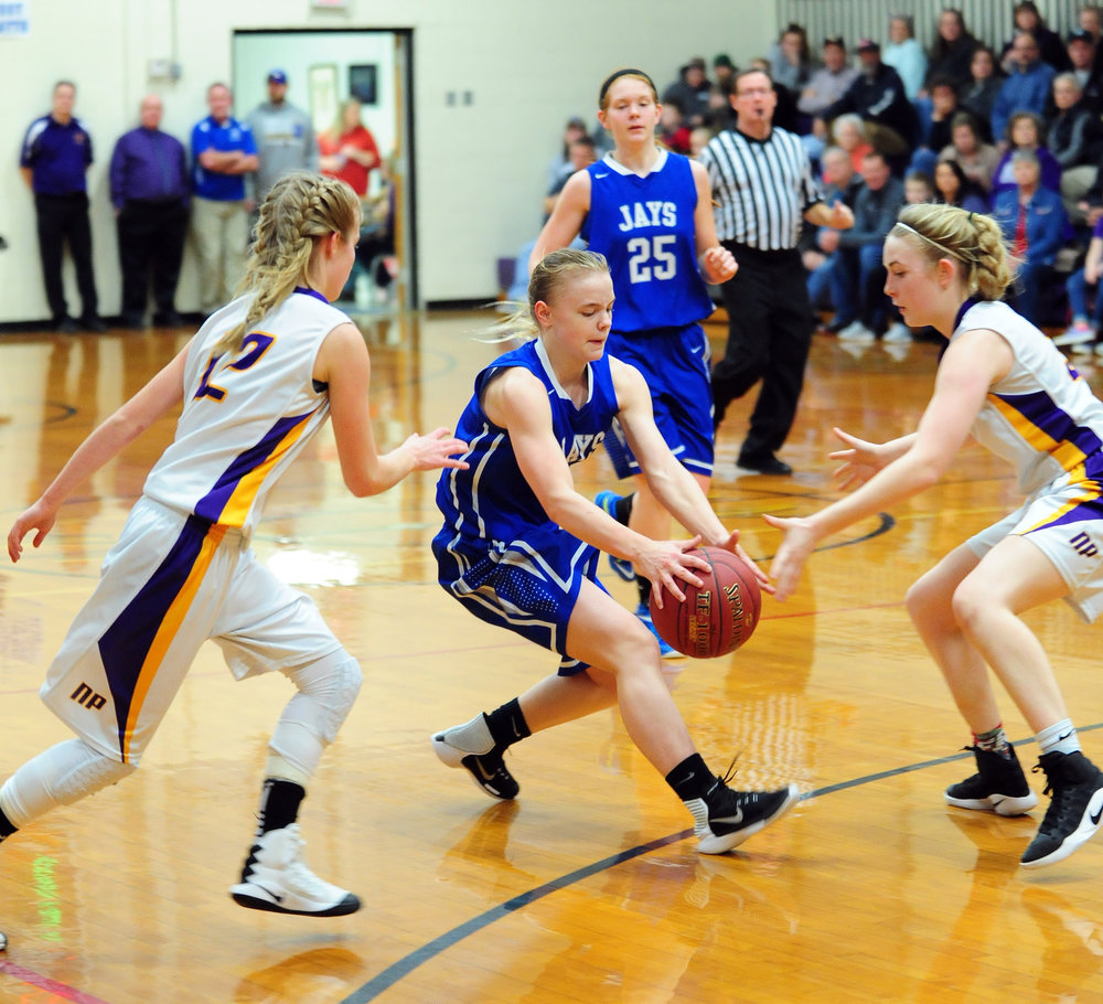 NICK INGRAM/Citizen photo West Platte freshman guard Faith Stevens, center, collects the ball between North Platte defenders McKenzie Sams, left, and Janell Manville on Friday, Jan. 27 in the fifth-place game of the North Platte Invitational at North Platte Junior High in Dearborn, Mo.