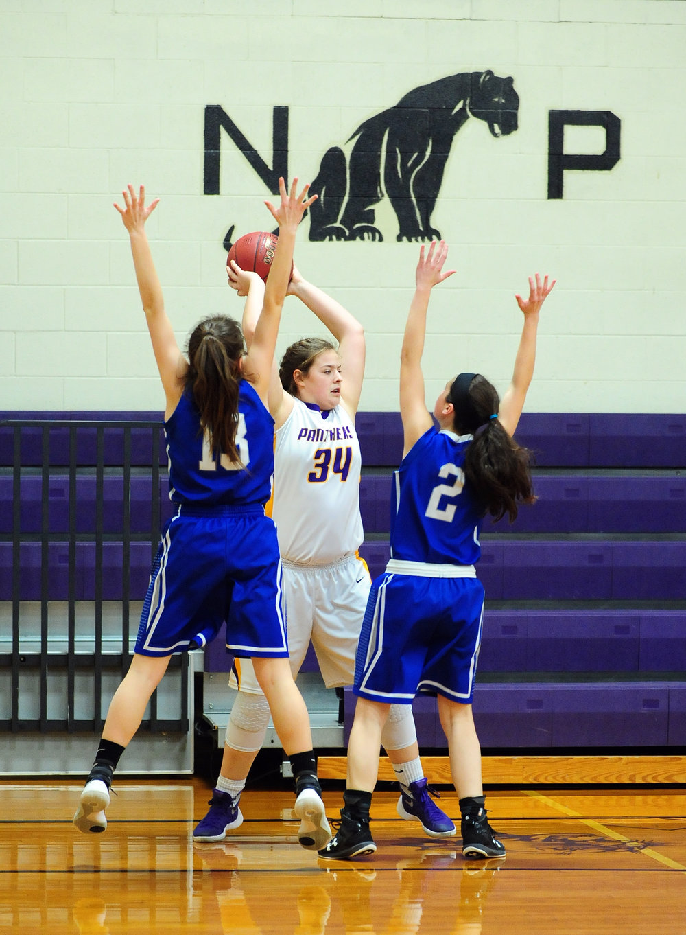 NICK INGRAM/Citizen photo North Platte freshman Jordyn Smith (34) looks to pass between two West Platte defenders Friday, Jan. 27 in the fifth-place game of the North Platte Invitational at North Platte Junior High in Dearborn, Mo.