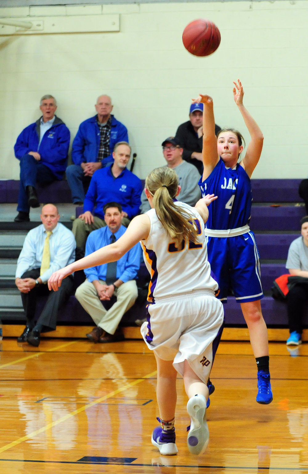 NICK INGRAM/Citizen photo West Platte junior Rachel Heili (4) takes a jump shot over North Platte's Grace Rice on Friday, Jan. 27 in the fifth-place game of the North Platte Invitational at North Platte Junior High in Dearborn, Mo.