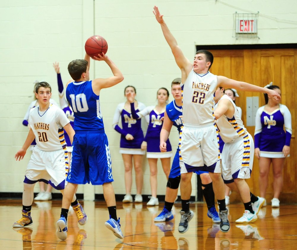 NICK INGRAM/Citizen photo North Platte junior Austin Snook (22) defends a shot Friday, Jan. 27 in the North Platte Invitational fifth-place game at North Platte Junior High in Dearborn, Mo.