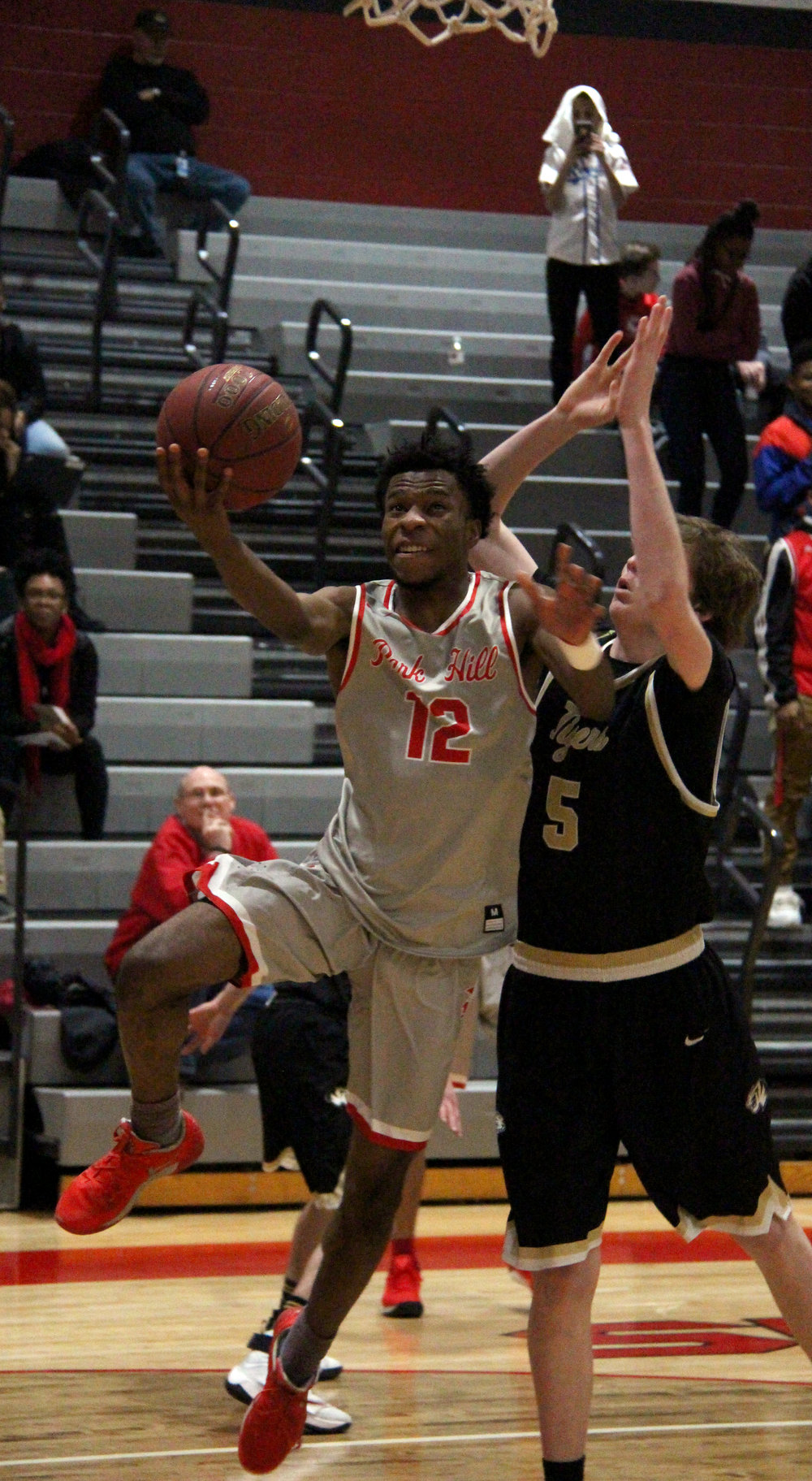 ROSS MARTIN/Citizen photo Park Hill senior guard Dru Smith (12) goes up for a layup against Lee's Summit on Friday, Jan. 27 at Park Hill High School in Kansas City, Mo.
