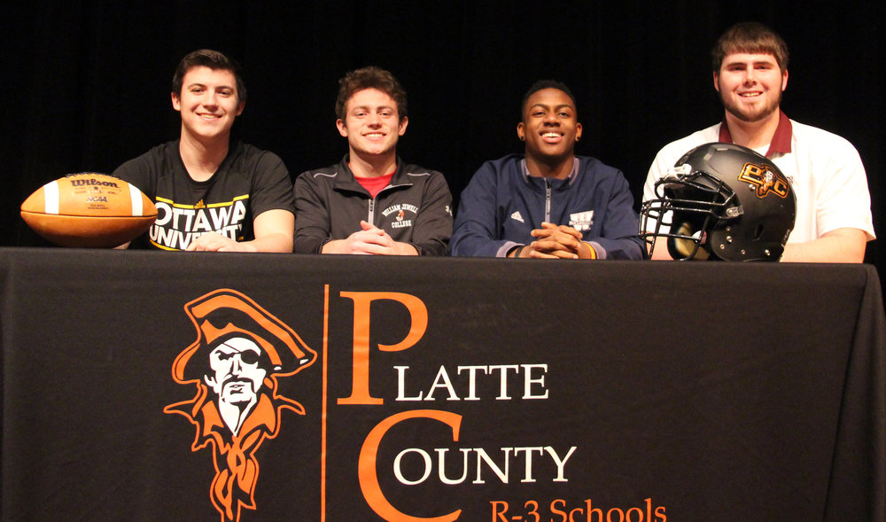 ROSS MARTIN/Citizen photo Platte County seniors (from left) Carter Nugent, TJ Guillory, Kevin Neal and Derek Kohler signed national letters of intent Wednesday, Feb. 1.
