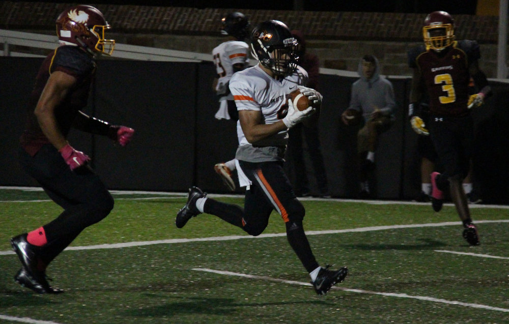 ROSS MARTIN/Citizen photo Platte County senior wide receiver TJ Guillory walks into the end zone between two Winnetonka defenders in a game earlier this season