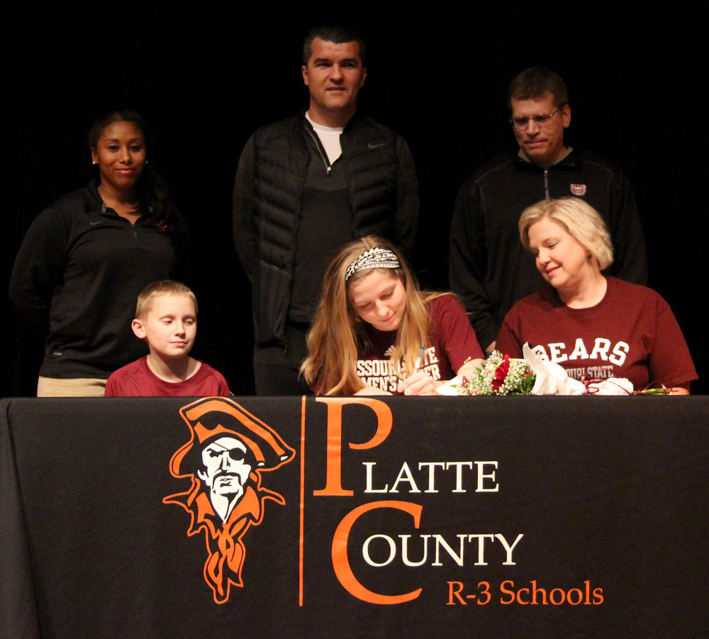 ROSS MARTIN/Citizen photo Platte County senior Amanda Sullivan, front middle, signs a national letter of intent to play soccer at Missouri State during a signing ceremony Wednesday, Feb. 1 at Platte County High School.