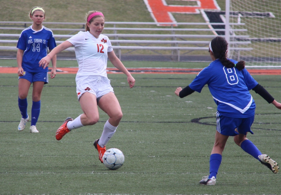 ROSS MARTIN/Citizen photo Platte County defender Amanda Sullivan (12) looks to make a pass in a 2015 game against St. Pius X.