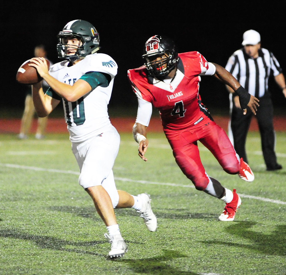 NICK INGRAM/Citizen photo Park Hill senior Chester Graves chases the quarterback during a game against Lawrence Free State this past season.