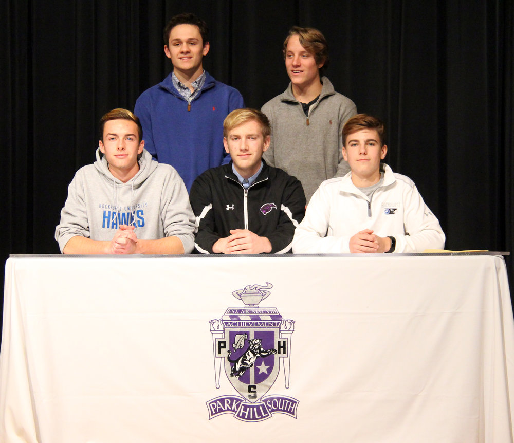 ROSS MARTIN/Citizen photo Park Hill South senior soccer players (front row, from left) Tyler Pisoni, Josh Wood and Turner Hall and (back row, from left) Ryan DiBernardo and Daniel Gunderson were honored during a signing ceremony Wednesday, Feb. 1 at Park Hill South High School in Riverside, Mo.