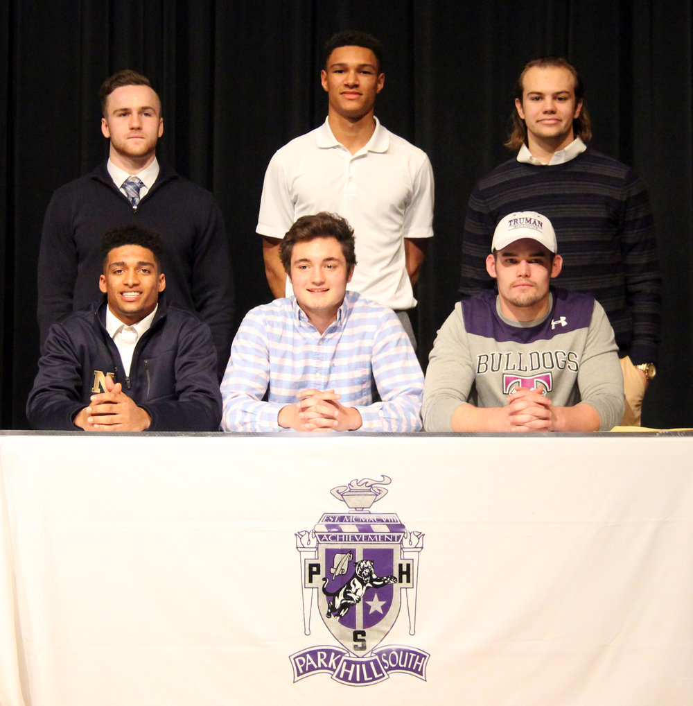 ROSS MARTIN/Citizen photo Park Hill South football players (front row, from left) Jake Springer, Everett Horton and Trace Weatherford and (back row, from left) Payton Ireland, Dillon Thomas and Zach Suchanick were honored during a national signing day ceremony Wednesday, Feb. 1 at Park Hill South High School in Riverside, Mo.