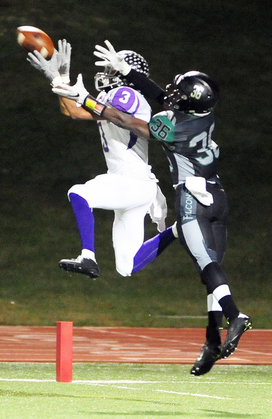NICK INGRAM/Citizen photo Park Hill South senior Jake Springer, front, hauls in a catch against Staley this past fall.