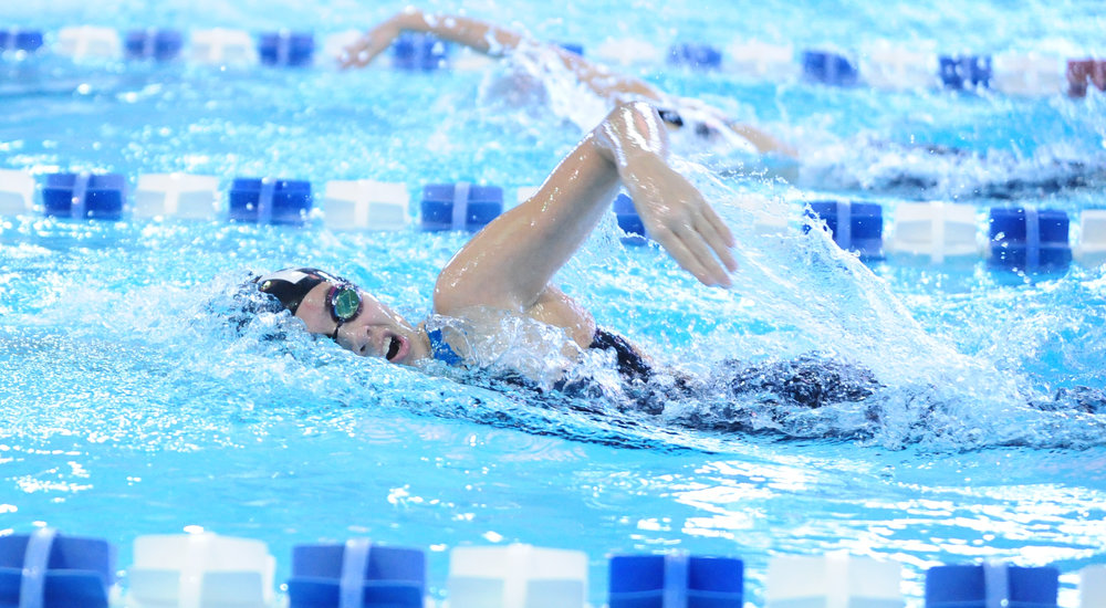 NICK INGRAM/Citizen photo Park Hill's Sophia Lane competes in the 200-yard freestyle during the Suburban Conference Gold Division championships on Saturday, Feb. 4 at Gladstone Community Center in Gladstone, Mo.