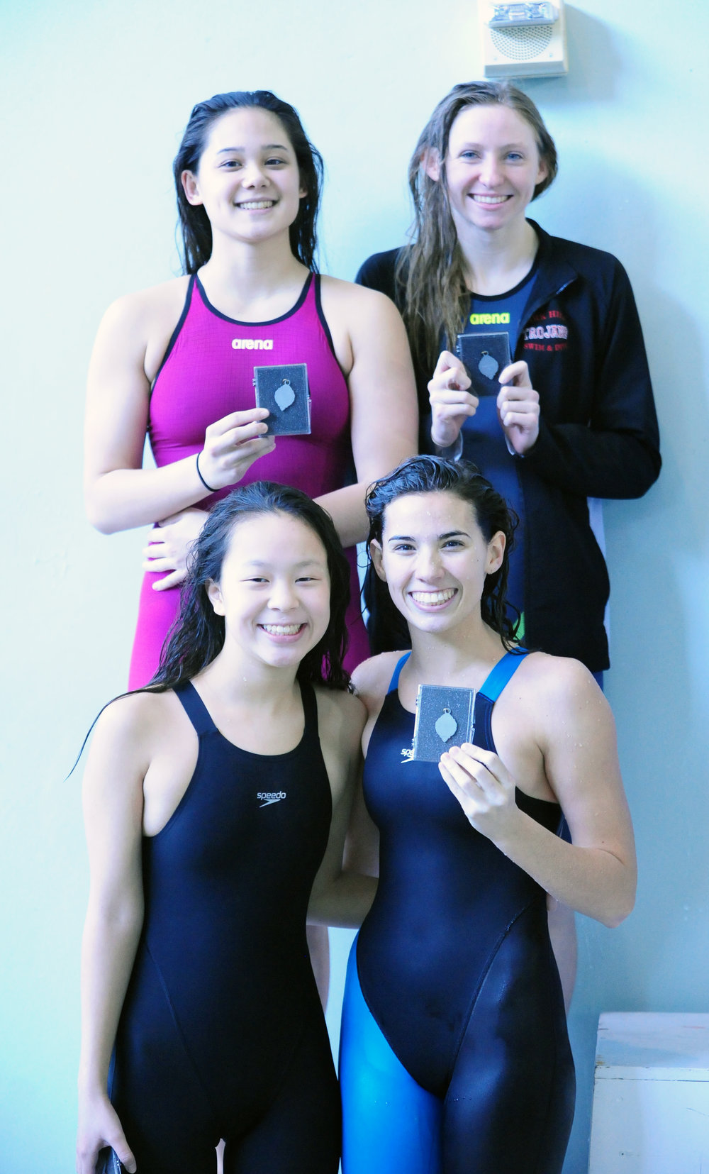 NICK INGRAM/Citizen photo Park Hill's Sophia Lane, Nani Welsh, Brooklyn Pierce and Emma Will set a school record in the 200-medley relay in the Suburban Conference Gold Division championships on Saturday, Feb. 4 at Gladstone Community Center in Gladstone, Mo.