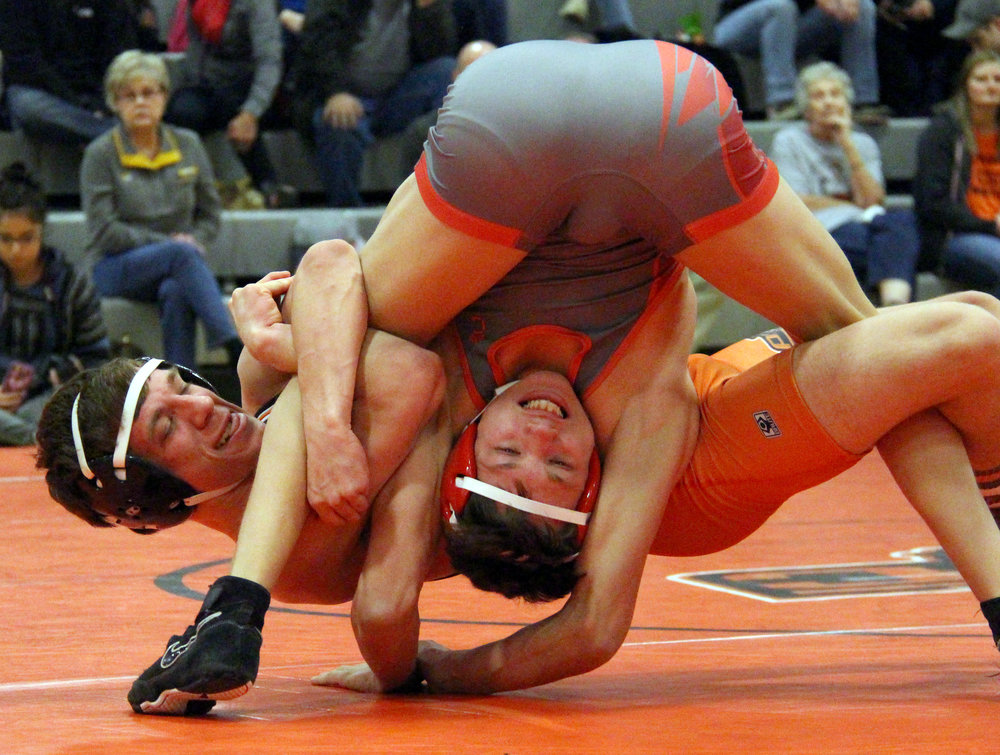 ROSS MARTIN/Citizen photo Platte County's Blake Bills, rear, works to pin Raytown South's Zach Hill with a spladle in a 120-pound match during a dual Thursday, Feb. 2 at Platte County High School.