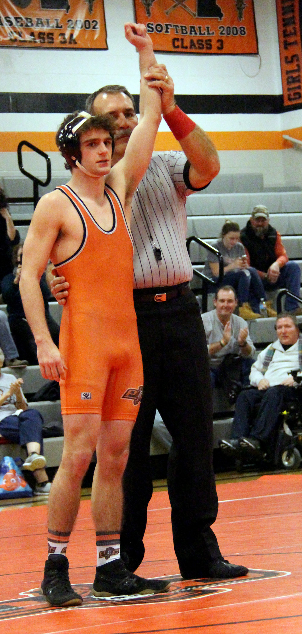 ROSS MARTIN/Citizen photo Platte County senior Zach Rolofson accepts a forfeit at 126 pounds during the Pirates' 60-13 victory.
