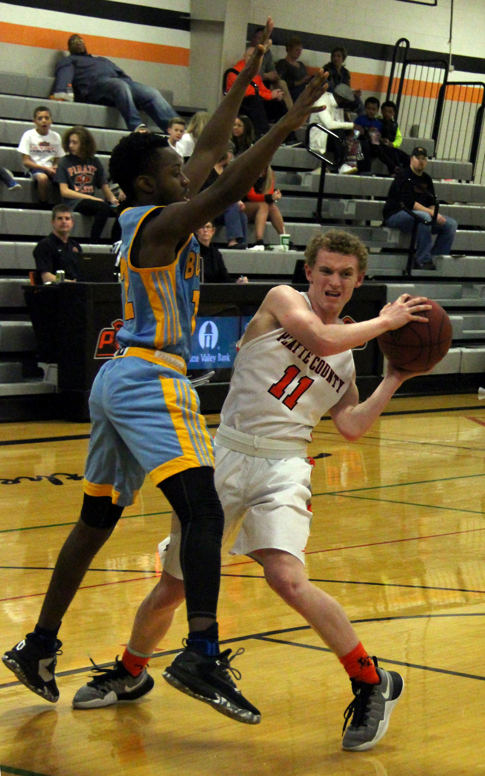 ROSS MARTIN/Citizen photo Platte County junior guard JP Post (11) looks to make a pass against Grandview.